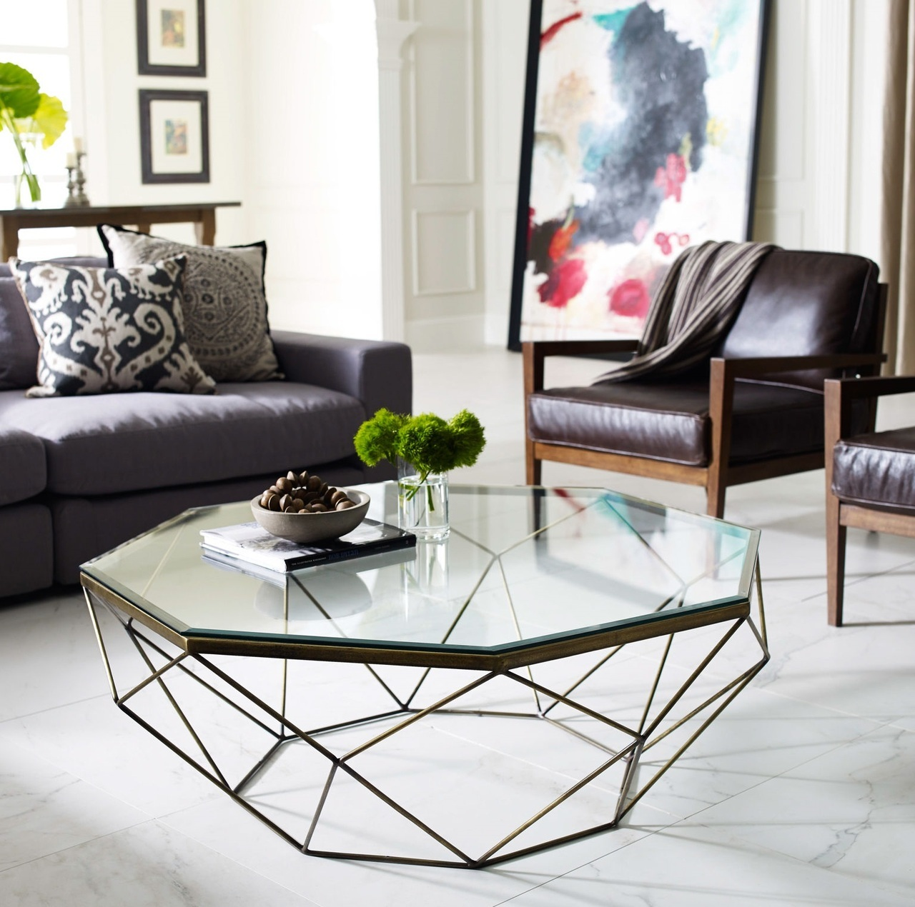 A-geometric-glass-coffee-table-adds-dynamic-and-transparency-to-the-room-