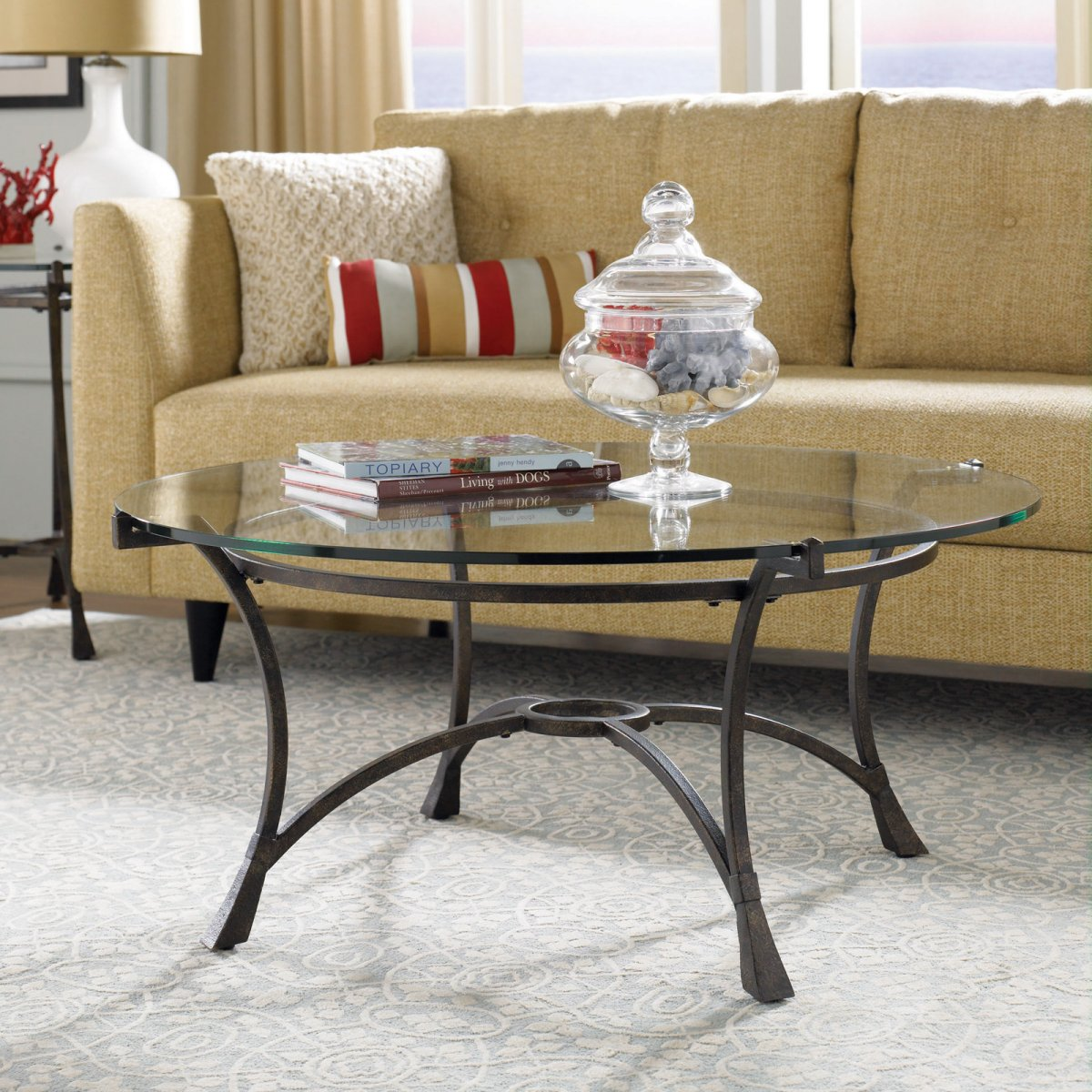 A-glass-coffee-table-with-metal-legs-is-a-daring-piece-that-feels-both-elegant-and-industrial